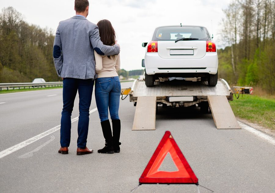 couples standing near the towing truck